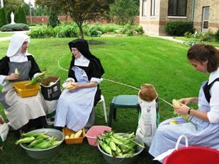 Sisters shucking corn
