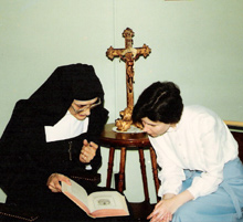 Retreatant and Sister reading book
